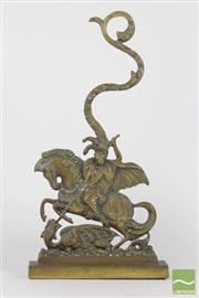 Sale 8521 - Lot 130 - Iron Base Brass Top Doorstop of A Warrior on Horse Back Fighting Dragon