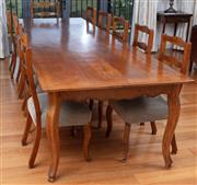 Sale 9005H - Lot 34 - A Louis XV style cherrywood plank top farmhouse dining table with shaped apron on cabriole legs, seats twelve, Height 77cm x Width 1...