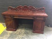 Sale 9048 - Lot 1084 - Regency Mahogany Sideboard, with bold Hope scroll back with leaf terminals, above three frieze drawers flanked by rosettes & on pede...