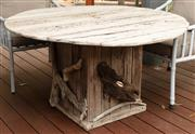 Sale 8904H - Lot 63 - A driftwood circular top outdoor table with embellished pedestal base. Height 70cm x Diameter 130cm (fairly weathered)