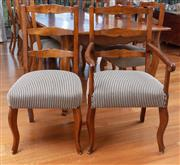 Sale 9005H - Lot 35 - A Set of twelve Cherrywood French style farmhouse ladder back dining chairs including two carvers with striped cord upholstered and...
