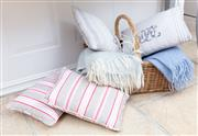 Sale 8866H - Lot 97 - Two French linen cushions and two others, together with two mohair blankets in a wicker basket