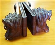Sale 8320 - Lot 824 - Indian teak and bone carved bookends in the form of lions resting against a book, 2 pieces