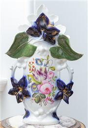 Sale 8595A - Lot 54 - A 19th Century porcelain mantle vase, boldly modelled with flowers and painted with roses and tulips, crack to body, chips - as foun...