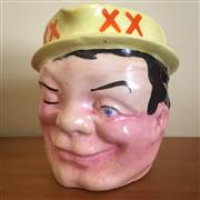 Sale 8878T - Lot 7 - Four XXXX Beer Jug of Winking Face, Circa 1950, height 14.5cm