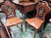 Sale 8714 - Lot 1047 - Pair of Mid Victorian Carved Mahogany Armorial Hall Chairs, the pierced backs and painted shields, on turned faceted legs