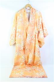 Sale 8904H - Lot 32 - A Vintage Japanese Kimono with blossom flowers on peach background.