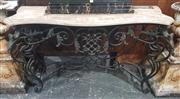 Sale 8917 - Lot 1008 - Wrought Iron Console Table, with an alabaster veneered serpentine top, brass leaf details & stretcher base