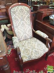 Sale 8424 - Lot 1095 - 19th Century French Mahogany Armchair, upholstered in floral fabric (distressed), raised on turned reeded legs