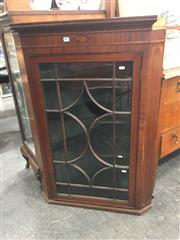 Sale 8714 - Lot 1076 - A Late Georgian Mahogany Hanging Corner Cabinet, with shell inlay to frieze & astragal door