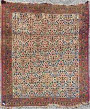 Sale 8939 - Lot 1045 - Antique Persian Wool Carpet, with diamond panels filled with flora, in cream & red tones (wear and losses) 167 x 155 cm