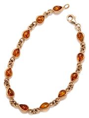 Sale 9095 - Lot 349 - A 14CT GOLD AMBER BRACELET; round links interspersed with 12 collets each set with a pear shape cabochon amber, to a parrot clasp, l...