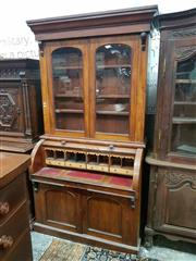 Sale 8976 - Lot 1093 - Victorian Mahogany Cylinder Bureau Bookcase, with two arched glass panel doors, a fitted interior with slide-out drawer & two panel...