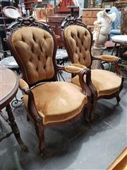Sale 8925 - Lot 1042 - A pair of carved and buttonback mustard upholstered elbow chairs