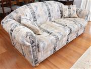 Sale 9005H - Lot 44 - A pair of camel back two seater fabric upholstered lounges with monochrome acanthus fabric upholstery and sundry cushions. Height of...