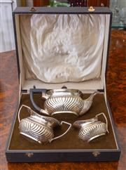 Sale 8649A - Lot 6 - A sterling  silver three piece tea set of gadrooned boat form, by J & C, RS, Ltd, Birmingham, B, 1926, in fitted case from Civil Ser...