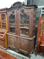 Sale 8917 - Lot 1064 - 19th Century French Oak Buffet a Deux Corps, carved with a basket, the two shaped glazed doors with fruit & flowers, with two furthe...