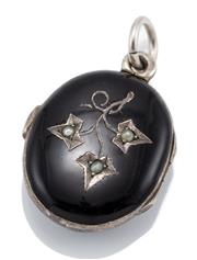 Sale 9066 - Lot 369 - A VICTORIAN ENAMEL AND SEED PEARL LOCKET; oval locket with black enamel to front and back, front applied with ivy leaf design set wi...
