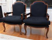 Sale 9005H - Lot 43 - A pair of Louis XV style bergeres with black linen upholstered back seats and elbow rests, Height of back 100cm x Width 76cm