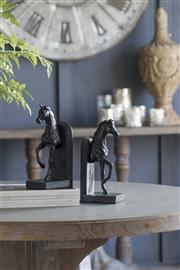 Sale 9075T - Lot 6 - Well crafted  polyresin horse form bookends combined with  rich black finish gives these horses a realistic appearance H:27x W:12.5...