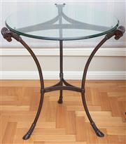 Sale 8562A - Lot 28 - A glass top wrought iron based occasional table with rams head supports, H 74 x D 64cm