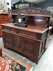 Sale 8848 - Lot 1088 - Late Victorian Carved Oak Sideboard, the body constructed and carved in the manner of a 17th century chest, the middle panel with cr...
