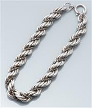 Sale 9037F - Lot 69 - A SILVER BRACELET; 8mm wide entwined rope twist and box chain to bolt ring clasp, length 20cm, wt. 15.73g.