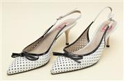 Sale 8661F - Lot 33 - A pair of D Marra, Italian made perforated leather slingback heels, white with black trim, size 40
