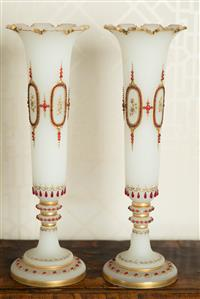 Sale 8392H - Lot 25 - A pair of Victorian opaque milk glass trumpet vases with ruby glass beading and gilt decoration, H 42cm