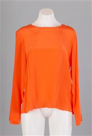Sale 8661F - Lot 30 - A Here comes the sun long sleeved silk top in orange, size 12