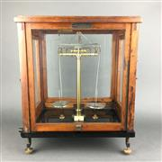 Sale 8638 - Lot 603A - Early Paul Bunge (Hamburg, Germany) precision brass laboratory beam balance, enclosed in a glass & wood case having front and side o...