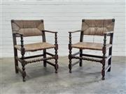 Sale 9085 - Lot 1029 - Pair of 19th Century Provincial Mixed Fruitwood Armchairs, with woven rush backs & seats, having turned posts & stretchers (h:85 x w...