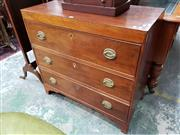 Sale 8728 - Lot 1053 - Regency Mahogany Chest of Three Drawers, of squared form, inlaid band to frieze & bracket feet