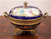 Sale 8804A - Lot 61 - A Sevres style and gilt brass mounted bonbonniere with painted reserves on a bleu de roi ground D 17cm