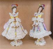 Sale 8368A - Lot 79 - A pair of German porcelain figures of women in lacy crinolines, H 21cm
