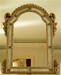 Sale 8392H - Lot 28 - A continental arch top carved and silvered mirror with floral and scrolling decoration, H 110 x W 86cm