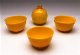 Sale 9114 - Lot 63 - Set of three Orrefors yellow ground glass bowls (Dia:11.5cm) together with a bulbous vase (H:12cm)