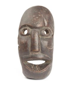 Sale 8575J - Lot 52 - A hardwood tribal mask, height 22cm, showing age