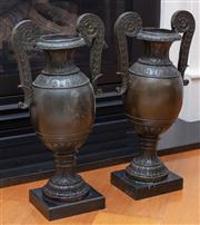 Sale 9005H - Lot 72 - A pair of bronze twin handled urn vases on square marble bases, Total Height 45cm