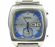 Sale 8402W - Lot 33 - SEIKO MONACO AUTOMATIC CHRONOGRAH WRISTWATCH; ref; 7016-5011 in stainless steel with cushion shape sunburst blue and silver dial, ce...