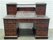 Sale 9085 - Lot 1062 - Victorian Mahogany Dickens Style Desk, with a gallery back, writing slope & two chests of four drawers each with Wellington style l...