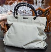 Sale 8746 - Lot 1065 - Gucci creme fabric handbag with black bamboo style handle including Prada dustbag (slight soiling)