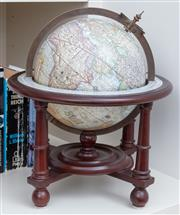 Sale 9005H - Lot 76 - A terrestrial globe in a timber stand, diameter 28cm