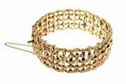 Sale 8333 - Lot 352 - A GOLD BRACELET; textured basket weave pattern with safety clasp and chain, marks worn and tests for 18ct, wt 51.5g, length 17.5cm.