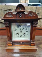 Sale 8714 - Lot 1093 - American Walnut Mantel Clock, with silvered dial, the glass door with attached columns
