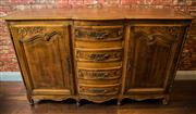 Sale 8448A - Lot 66 - Beautifully proportioned Louis XV style bow fronted sideboard featuring superb hand-carved detail to panel doors and drawers, on cab...