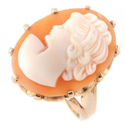 Sale 9145 - Lot 362 - A 9CT GOLD CAMEO RING; cut down claw set with a carved shell cameo depicting a female portrait, size 21 x 15mm, on a crown gallery,...
