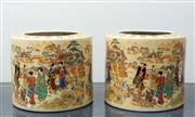 Sale 8562A - Lot 9 - A pair of Japanese porcelain planters, with Qianlong mark, decorated with ladies walking in gardens, H 17cm