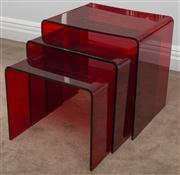 Sale 8575H - Lot 80 - A nest of red acrylic tables, scratched H of tallest 40cm