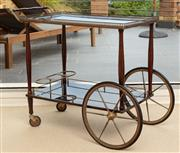 Sale 9066H - Lot 142 - A vintage timber drinks cart with brass gallery and large front wheels. H 74cm W 95cm D 47cm